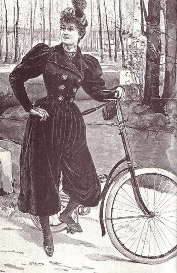 Bicyclist wearing practical bloomers. (Still looks like she's wearing a corset though.)