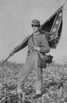 Civil War flag bearer--the colors of the Confederate Battle Flag look reversed.