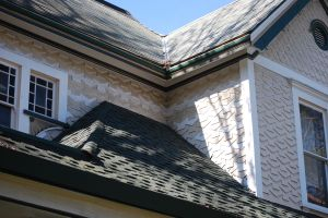 Two different shingle patterns on the body of the house and the gable.