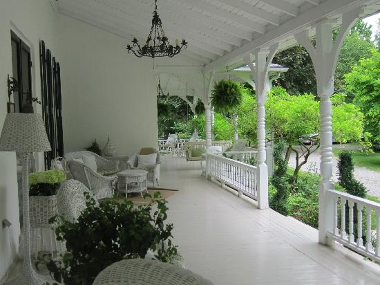 The Front Porch of the Grand Victorian Bed and Breakfast in Ontario, Canada. This is exactly the type of front porch that we don't have on our house. Photo Source: Tripadvisor.